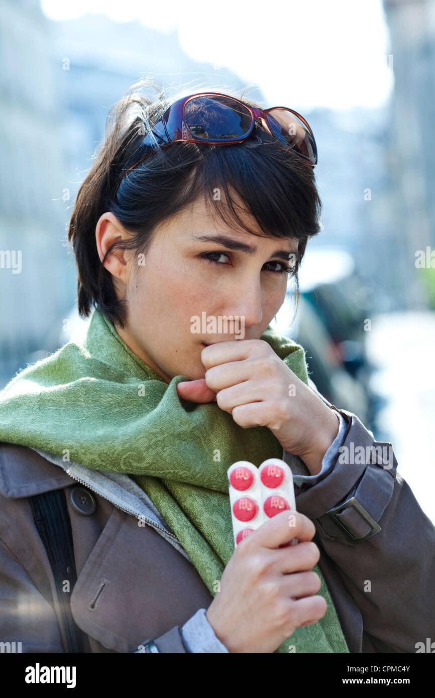 WOMAN TAKING MEDICATION - Stock Image