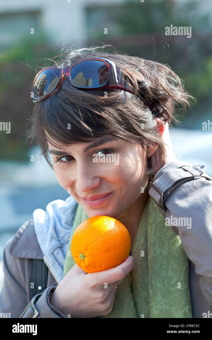 WOMAN EATING FRUIT - Stock Image