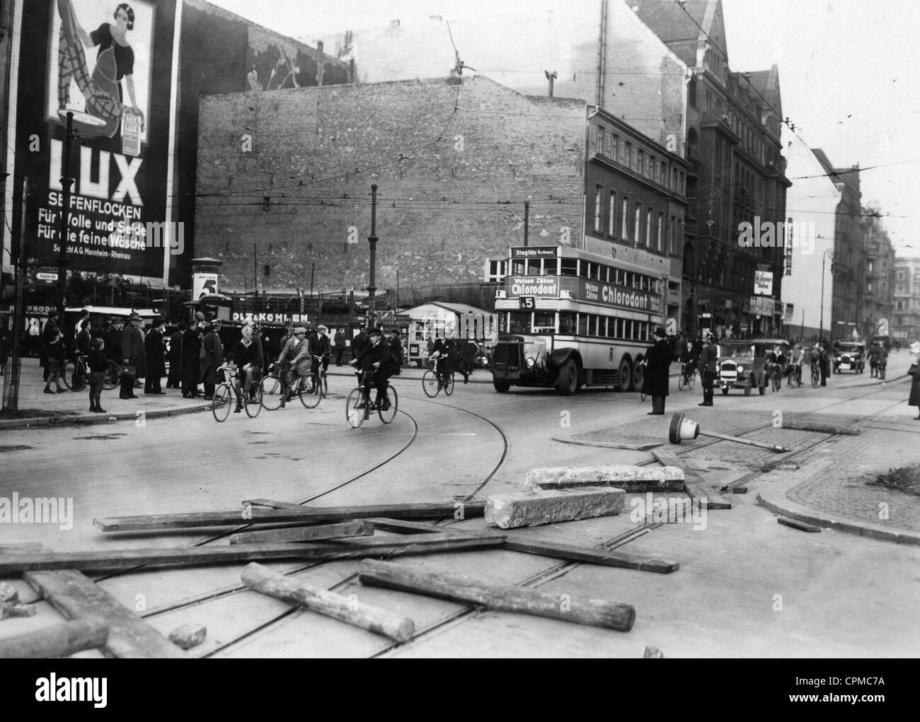 Tram rails are made unpassable with stone posts and wooden planks and beams, during the BVG public transport strikes - Stock Image