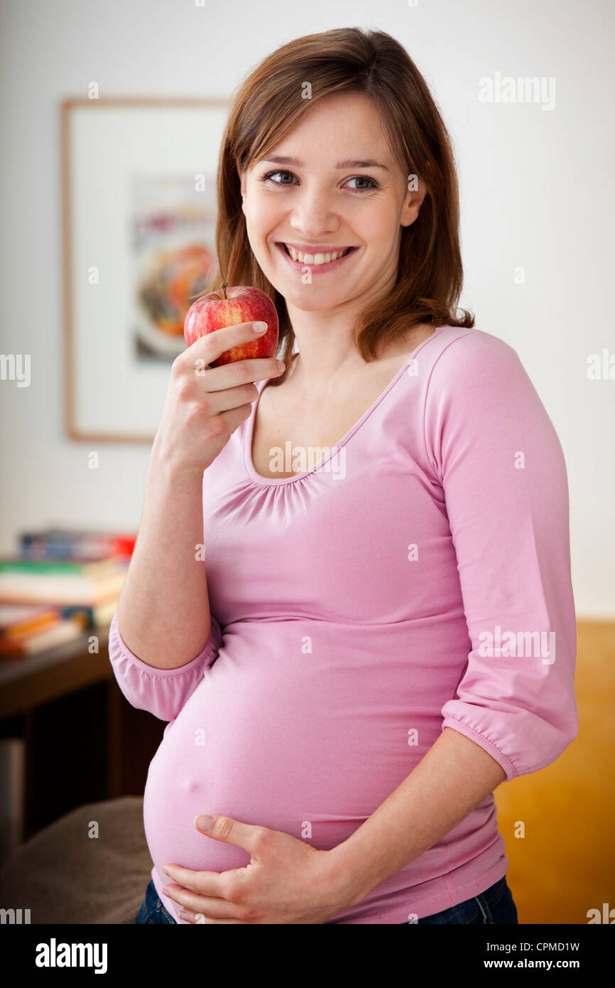 PREGNANT WOMAN EATING - Stock Image