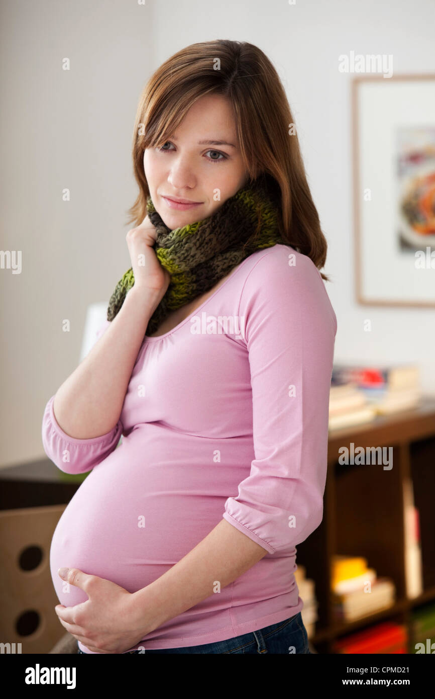 PREGNANT WOMAN WITH SORE THROAT - Stock Image