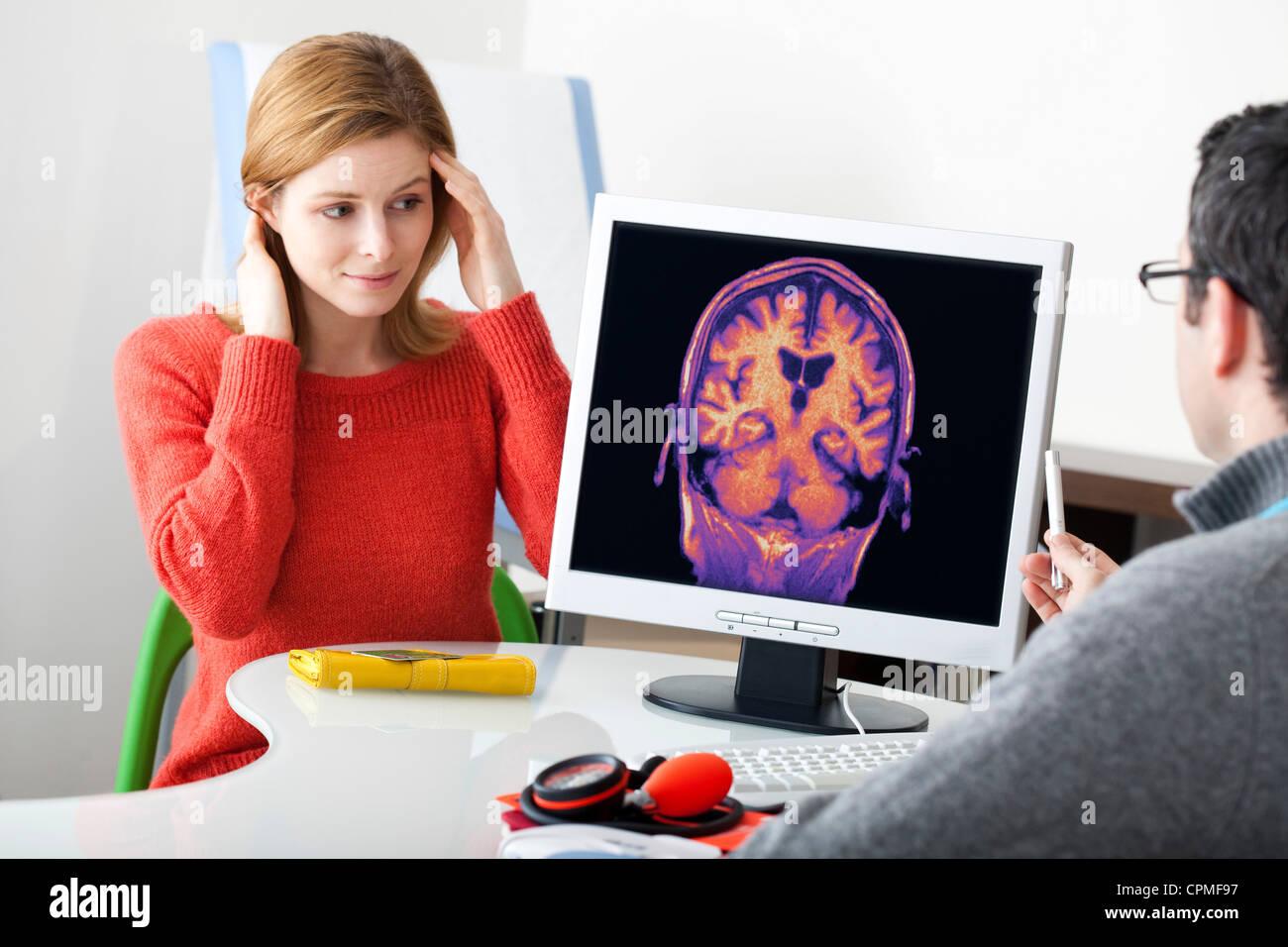 NEUROLOGY CONSULTATION WOMAN - Stock Image