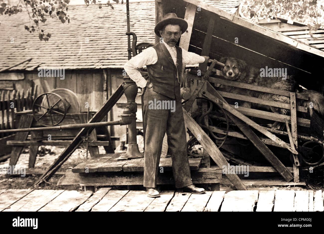 Slave Driver & Dog Powered Machinery - Stock Image