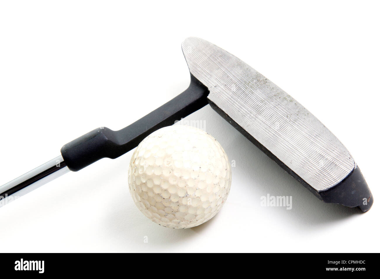 putter and golf ball on white background - Stock Image