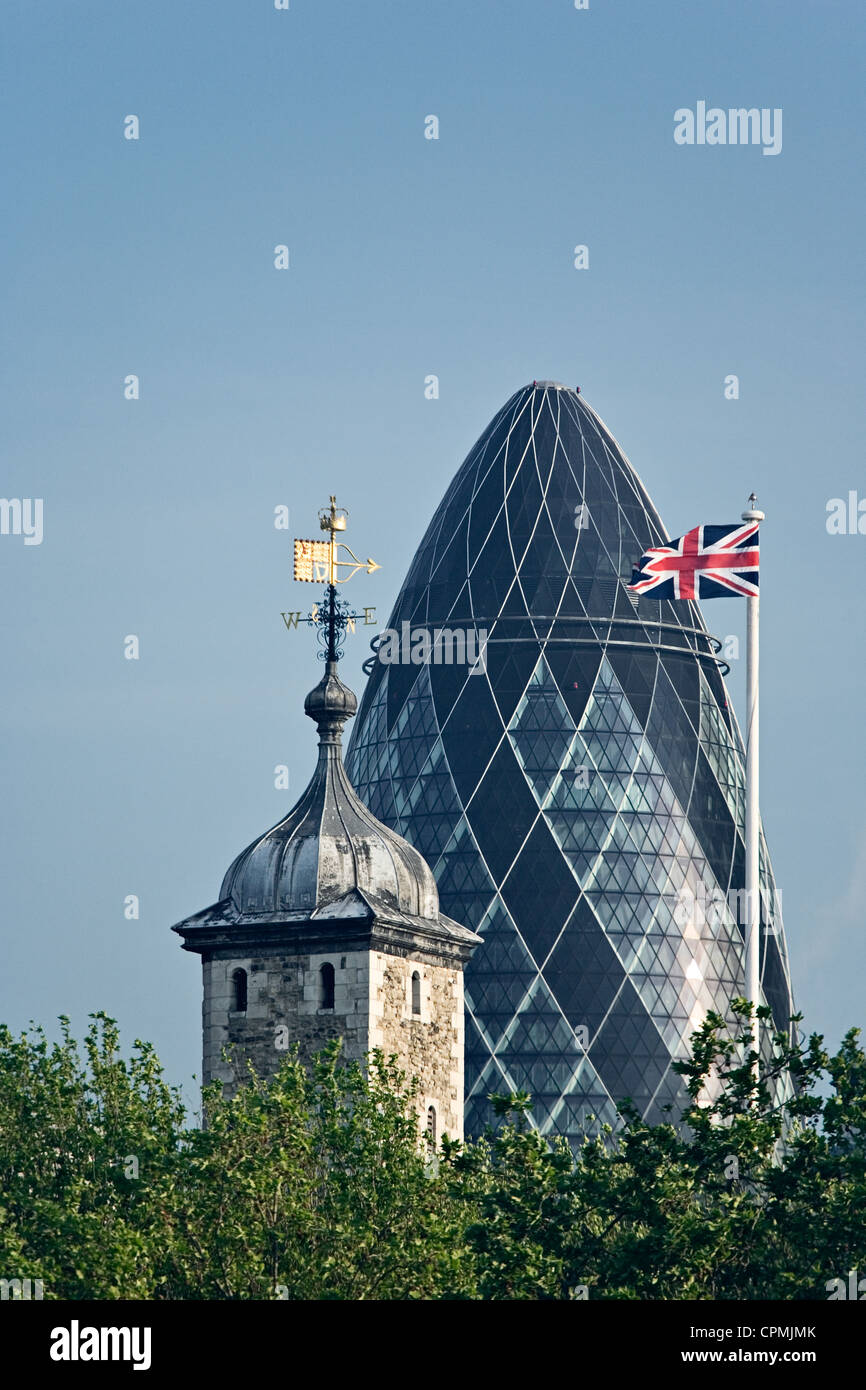 London's Gherkin, the Tower of London and the Union Jack flag as viewed from the South East. - Stock Image