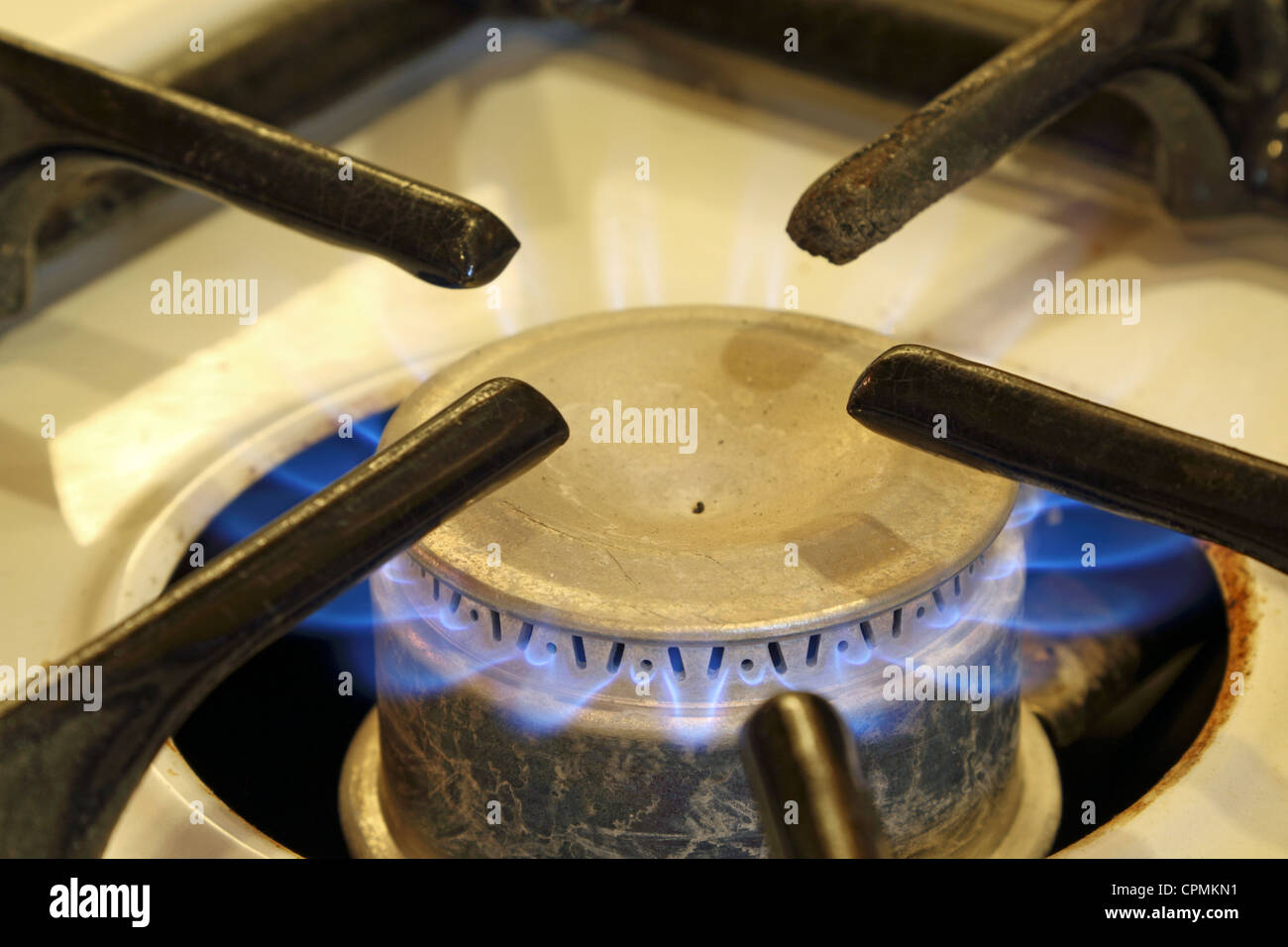 Gas jet burning on an old stove. Stock Photo