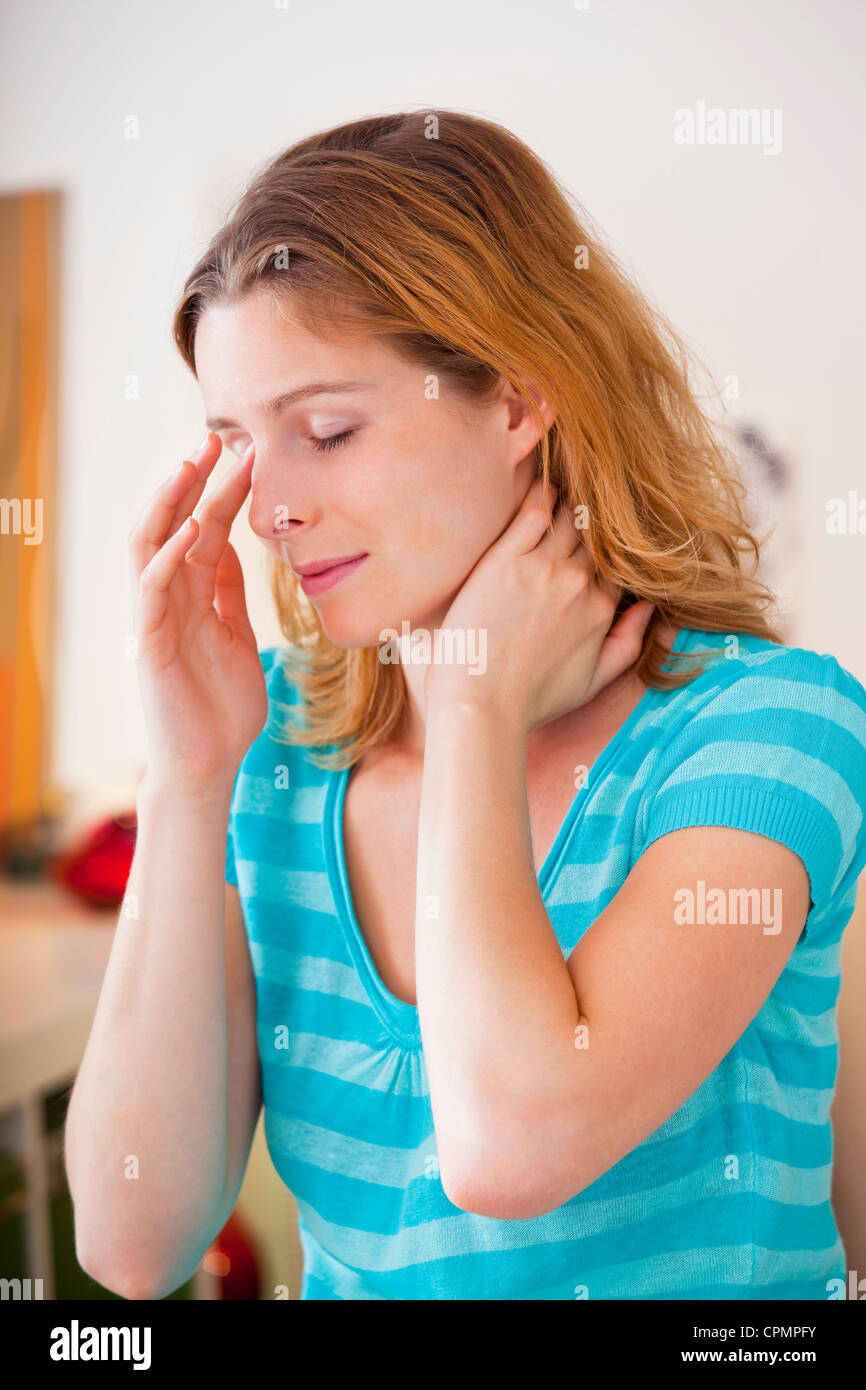 SINUSITIS IN A WOMAN - Stock Image