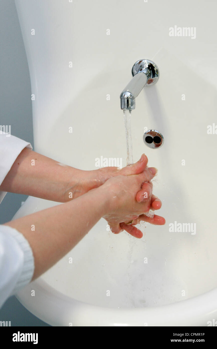 HAND WASHING IN HOSPITAL - Stock Image
