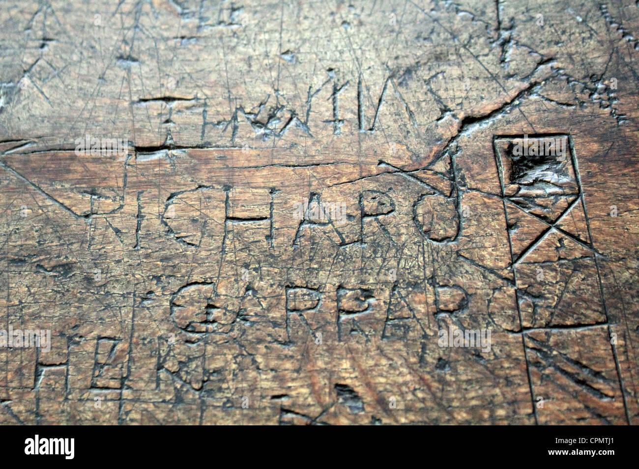 Ancient graffiti on tables inside st edmunds church southwold suffolk england uk stock image