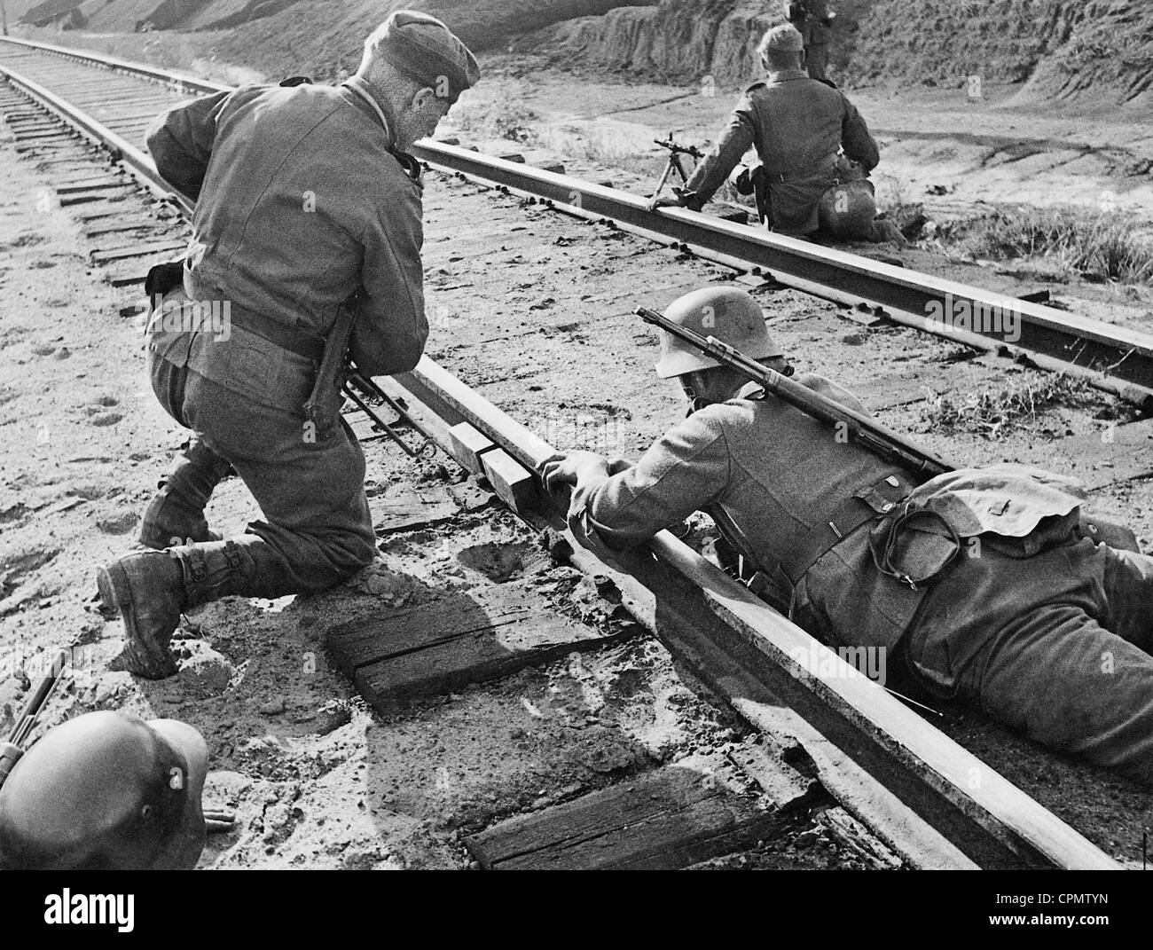 German engineers remove an explosive charge from railway tracks - Stock Image