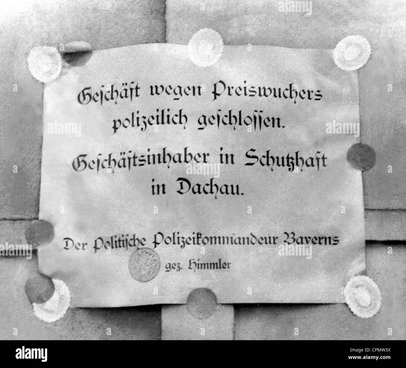 Public notice of the closure of a business due to the detainment of the proprietor in a Dachau concentration camp, - Stock Image