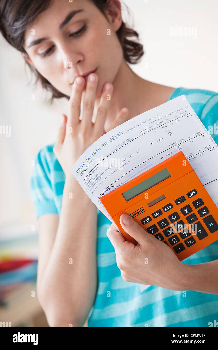 WOMAN DOING PAPERWORK - Stock Image