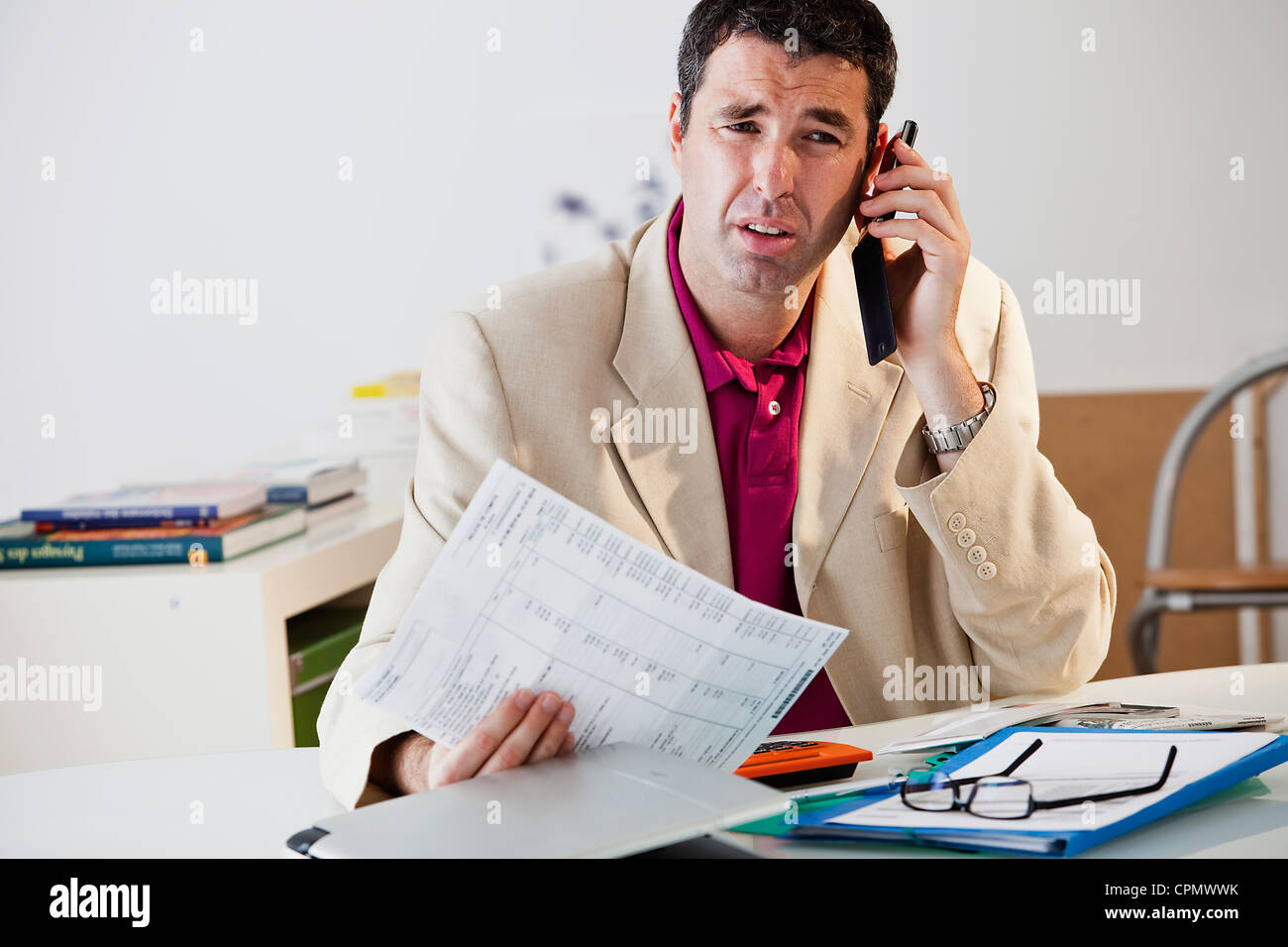 MAN FILLING OUT FORMS Stock Photo