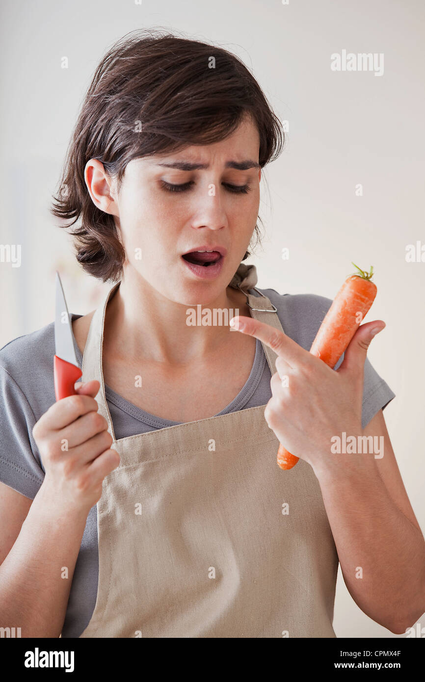 WOMAN IN  KITCHEN - Stock Image