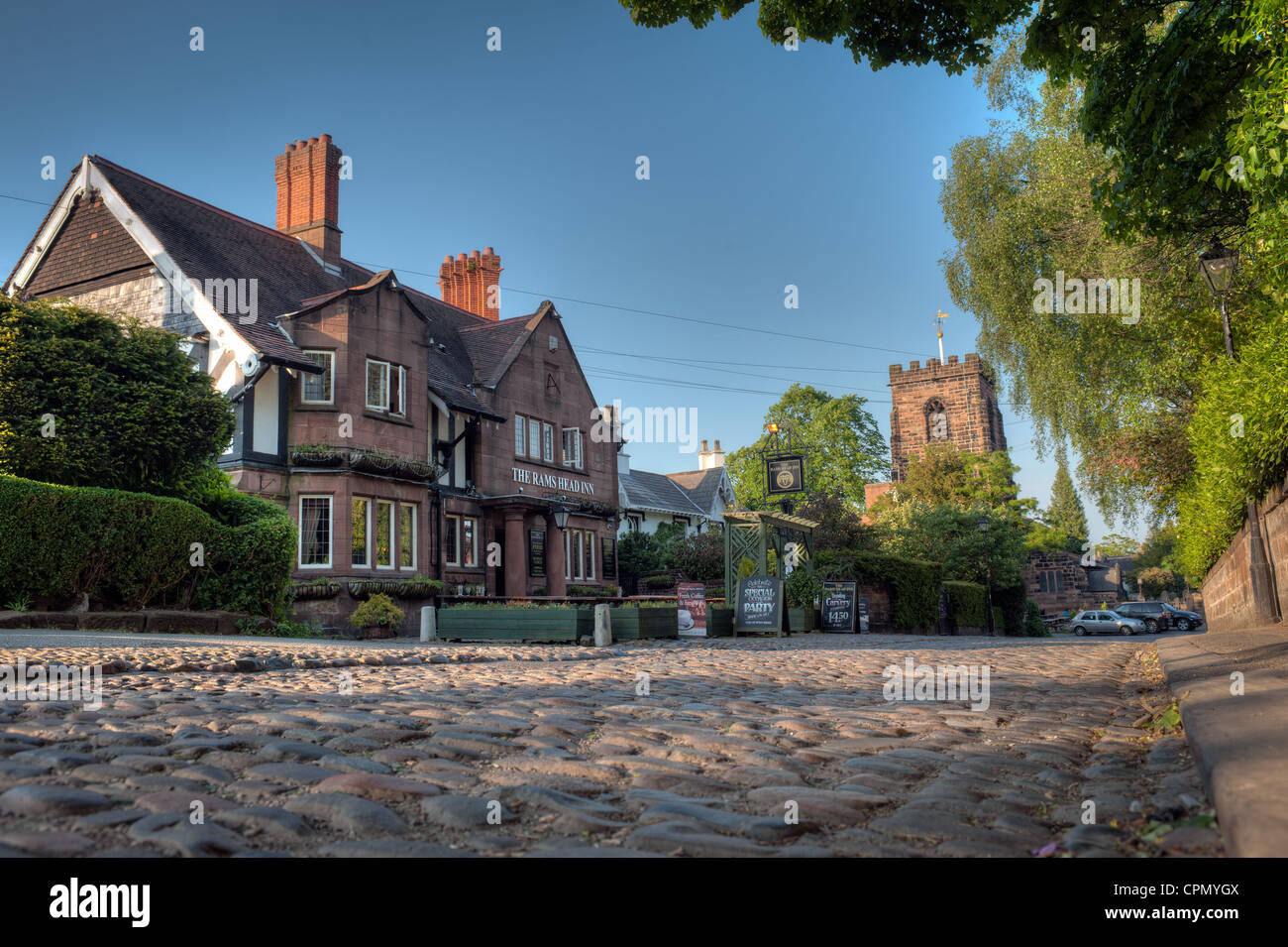The Rams Head public house in Grappenhall village, Warrington, Cheshire, England. A picturesque village with a cobbled - Stock Image