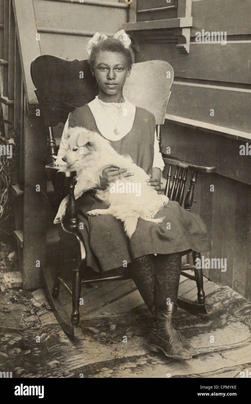 Groovy African American Girl In Rocking Chair Holding White Dog Squirreltailoven Fun Painted Chair Ideas Images Squirreltailovenorg