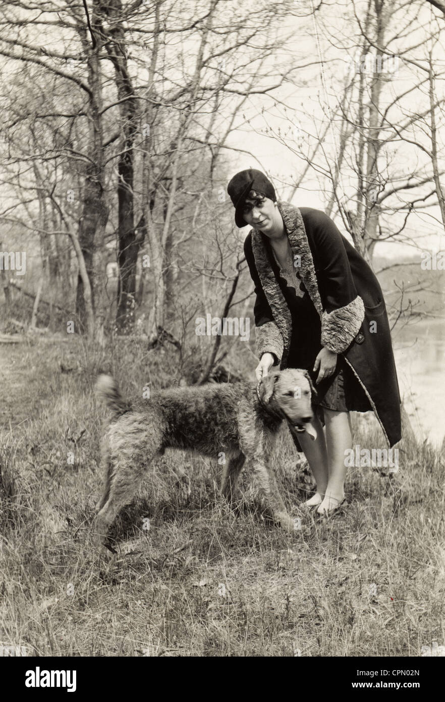 Woman & Look-Alike Airedale Terrier in the Woods - Stock Image