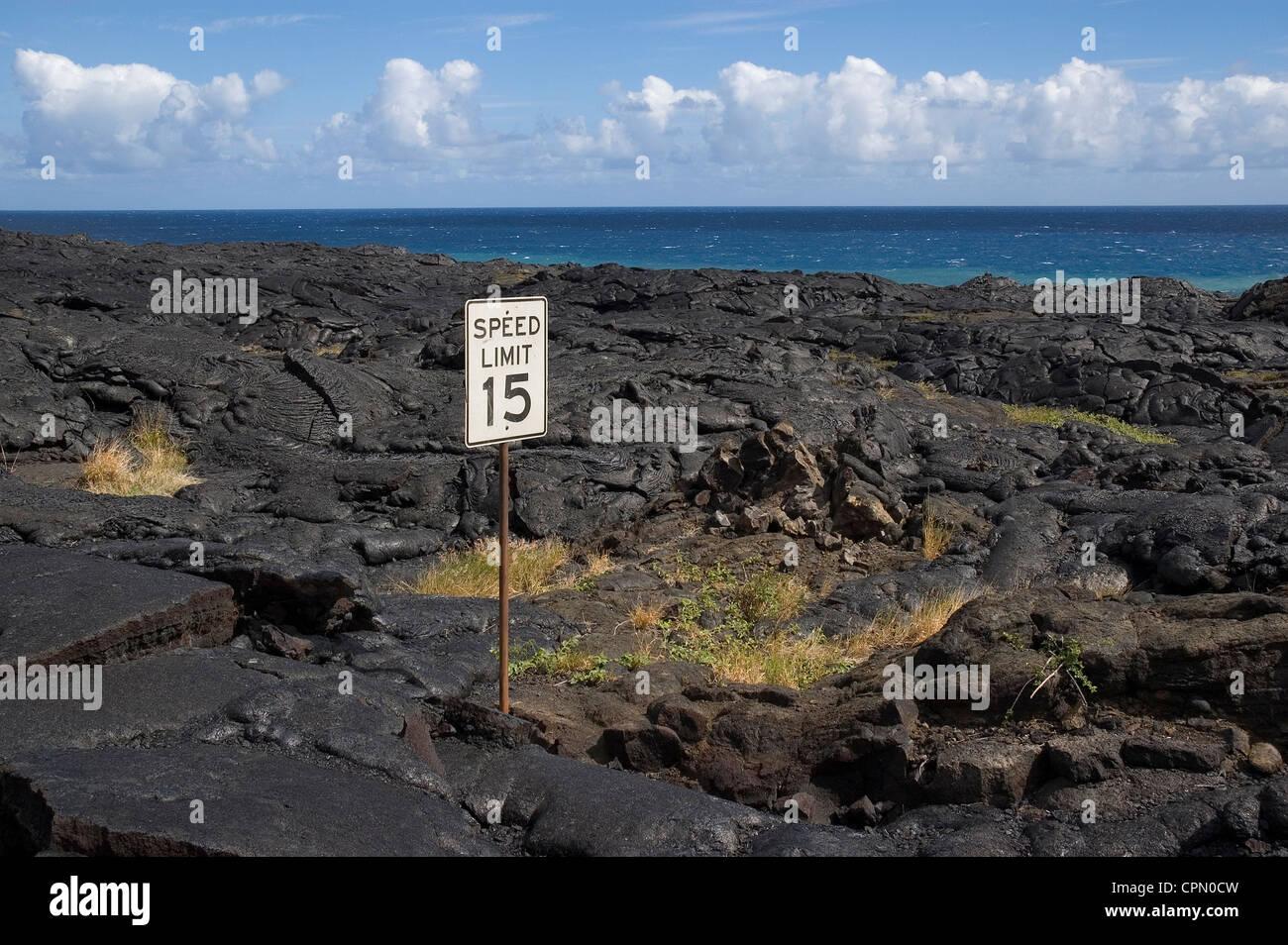 Elk284-2662 Hawaii, HI, Volcanoes NP, South Coast, road sign in lava flow - Stock Image