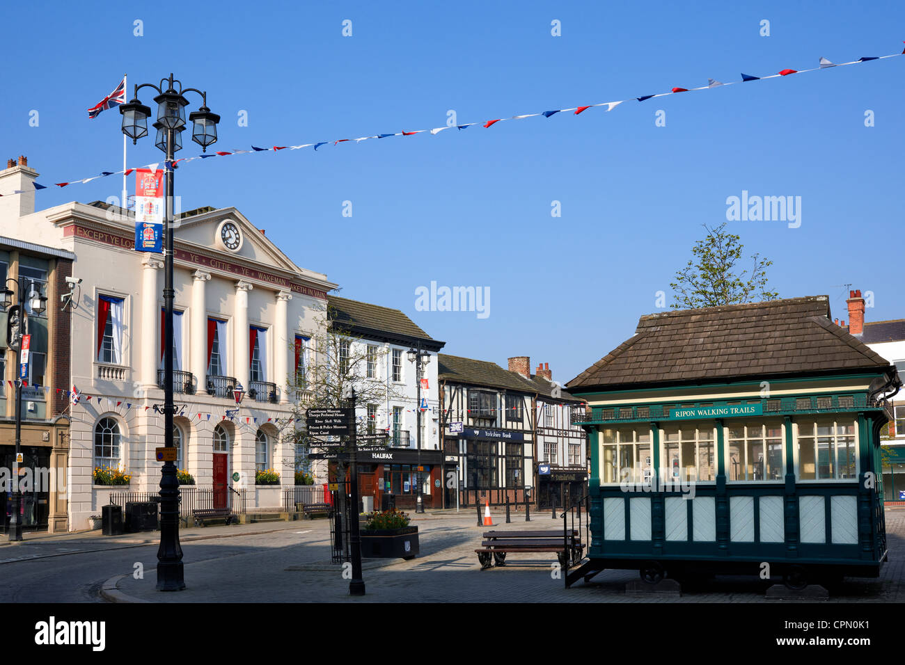 Ripon Market Square with Town Hall to the left and original cabbies shelter to the right. Stock Photo