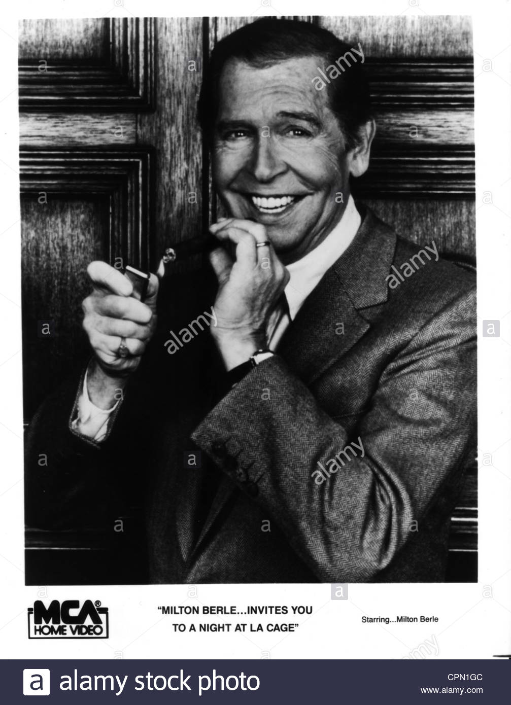 1970's - Milton Berle poses for a portrait holding a cigar. Editorial use only. Photo Courtesy Granamour Weems - Stock Image