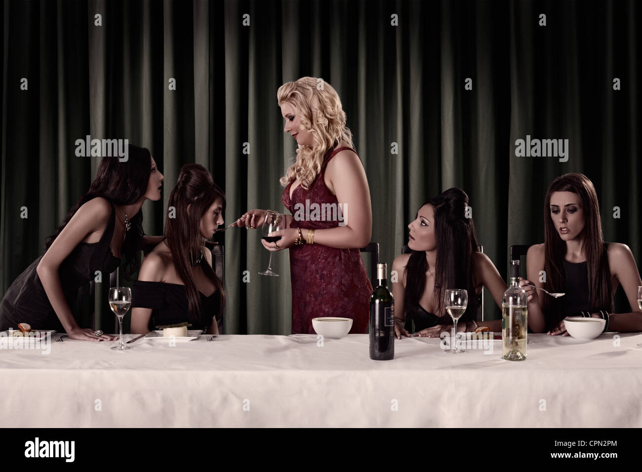 The First Supper (set of 4) ... 2 models portraying two diners each - Stock Image
