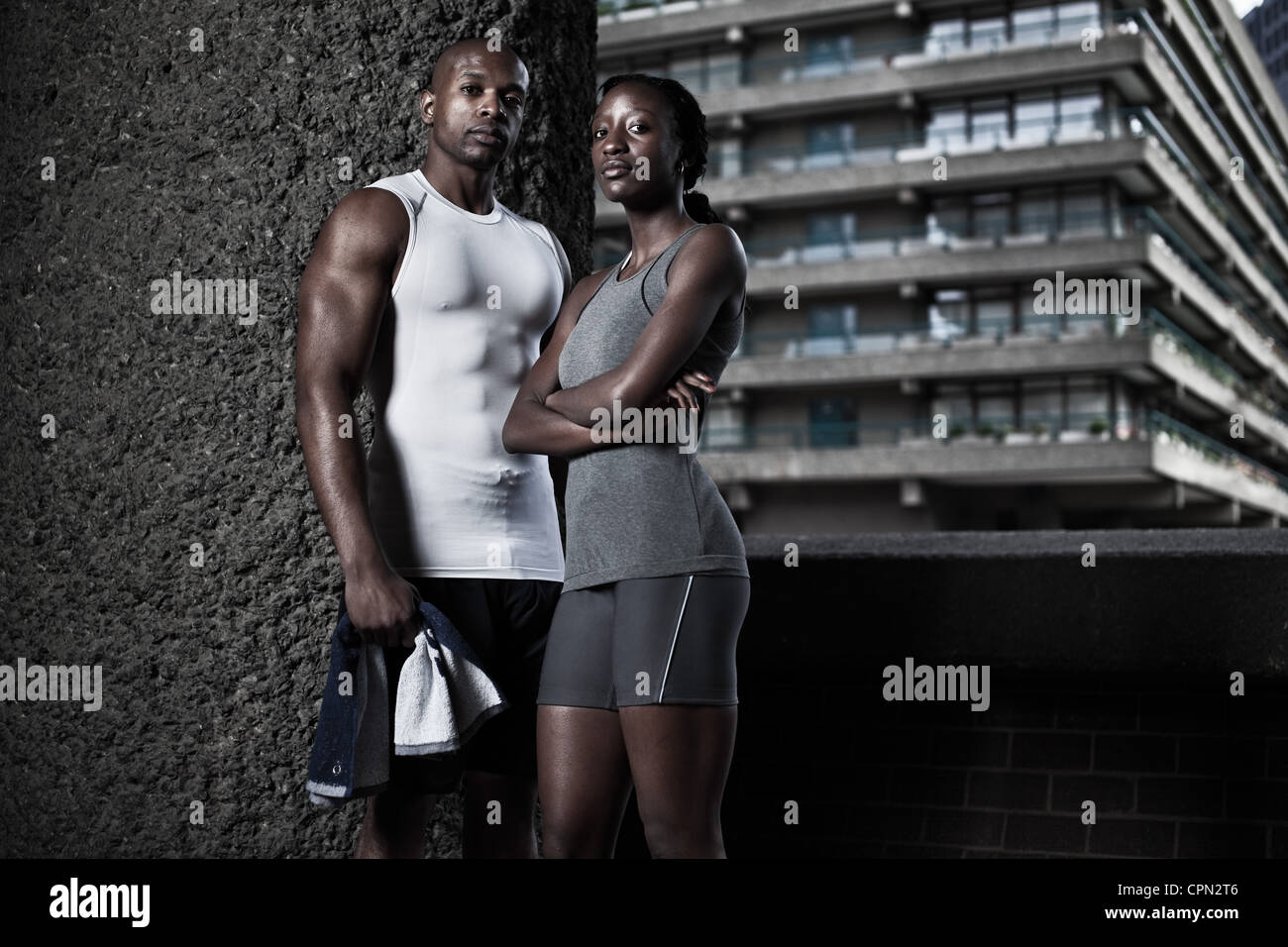 Man and woman in fitness clothing in urban environment - Stock Image