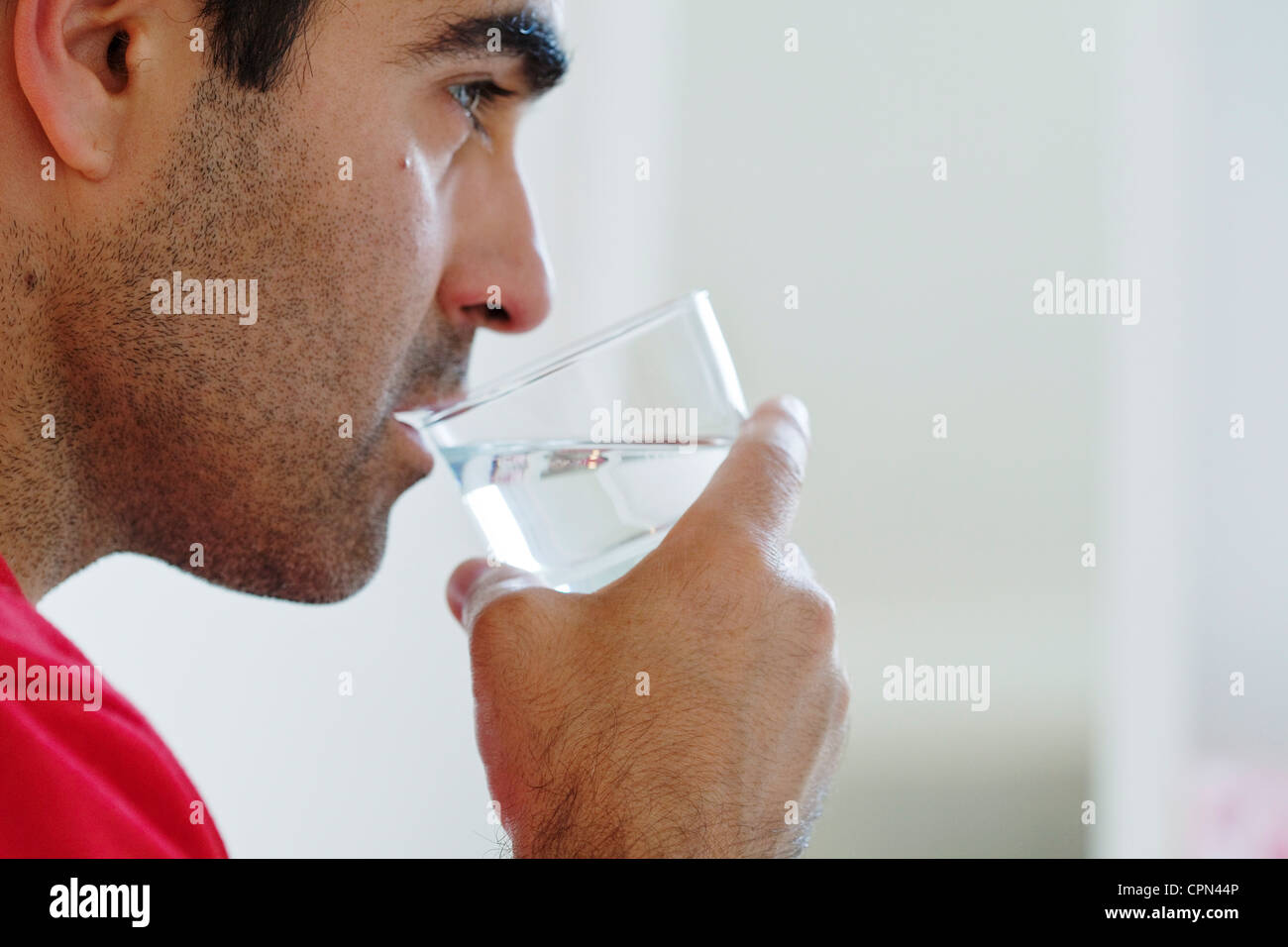 MAN WITH COLD DRINK - Stock Image