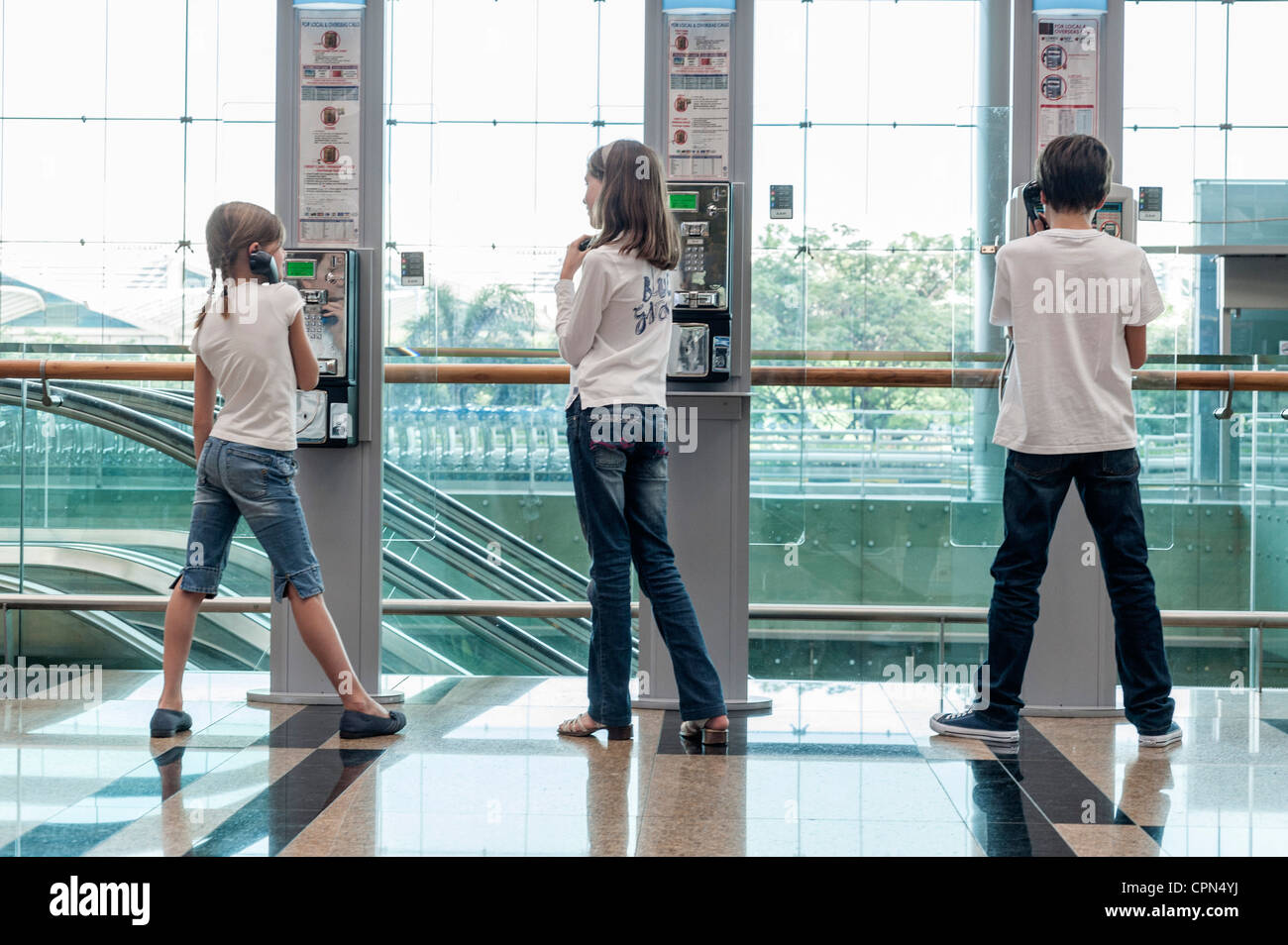 Children using payphones - Stock Image