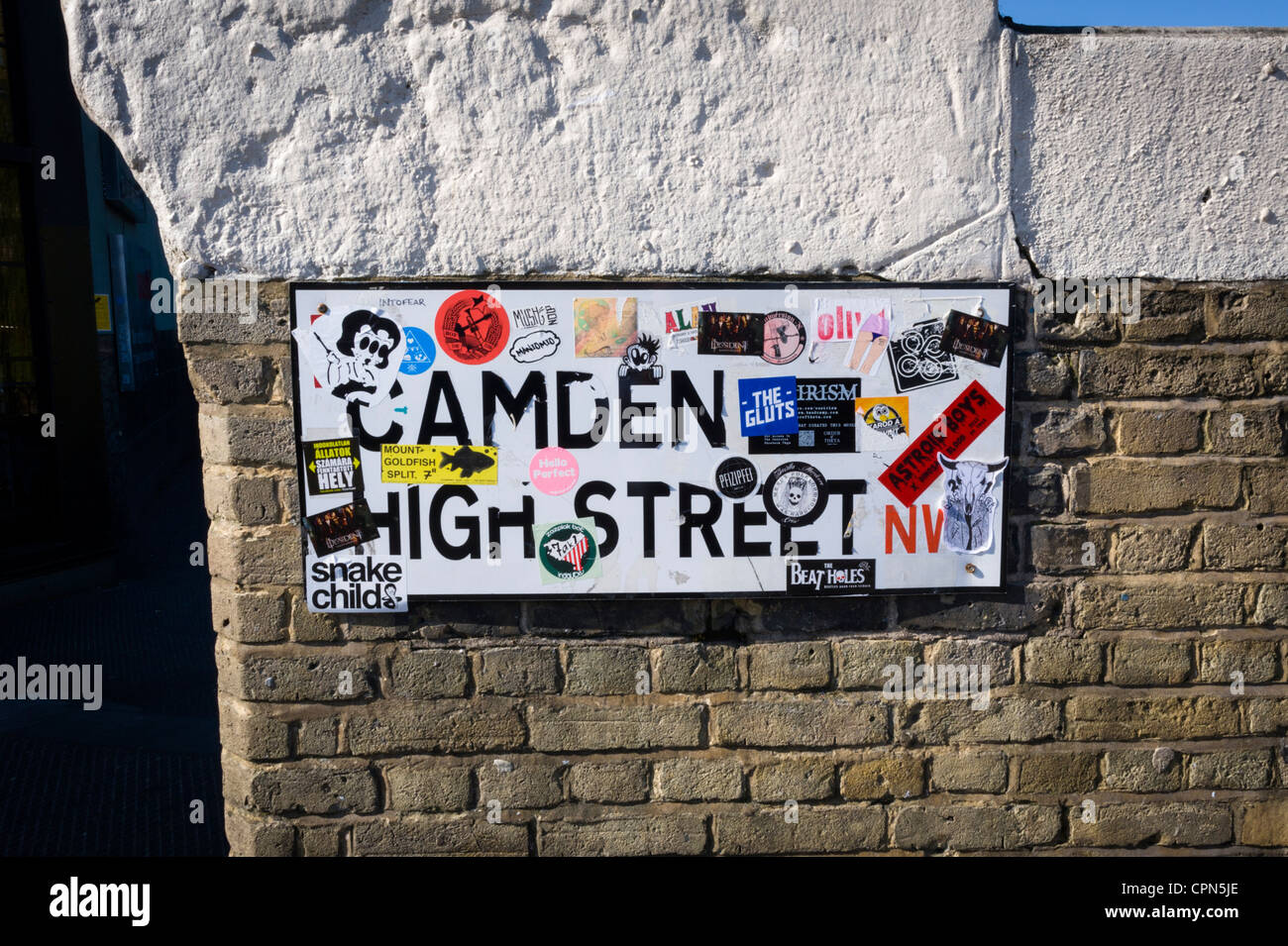 London Camden Town Lock Market Stables Camden High Street street road sign stickers advertising businesses events - Stock Image