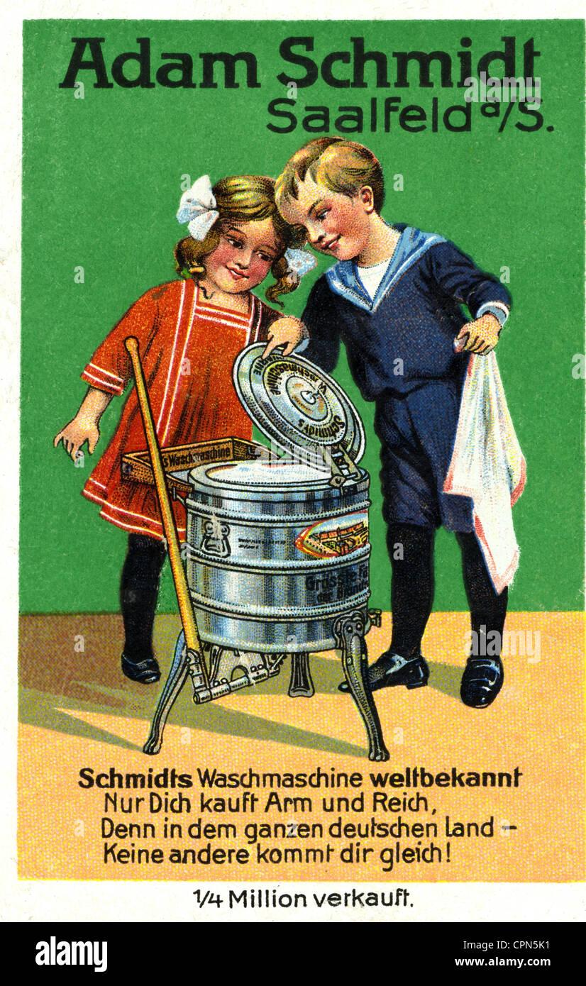 advertising, household, washing machine, boy and girl gaze in wonder of the Adam Schmidt Company, Saalfeld, Germany, - Stock Image