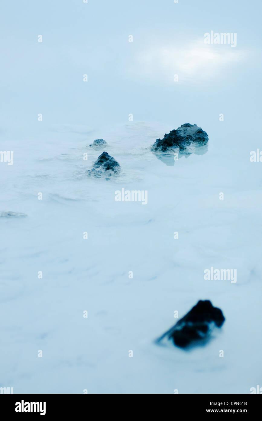 Volcanic rocks in Blue Lagoon, Reykjanes Peninsula, Iceland - Stock Image