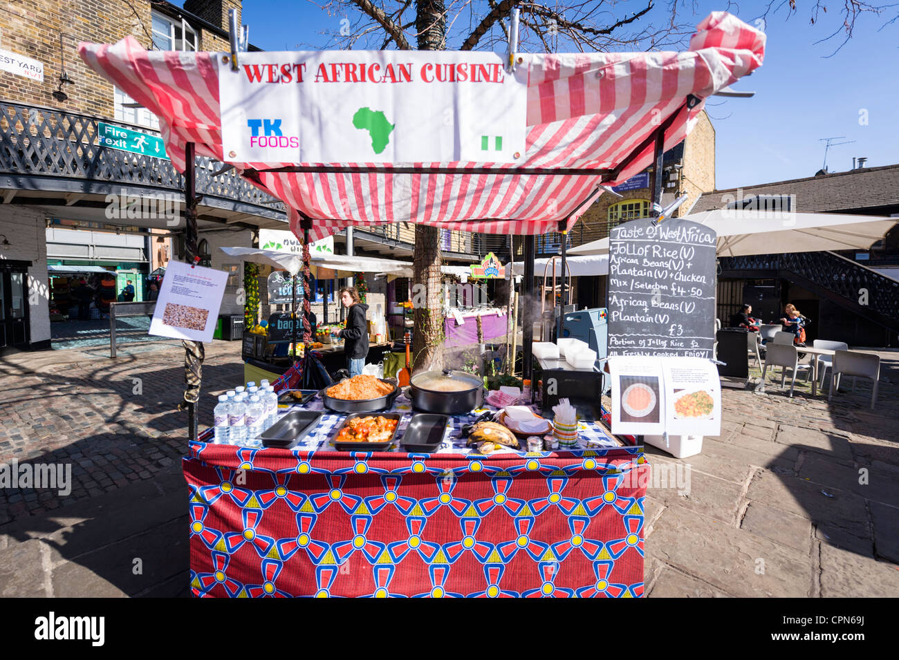 London Camden Town Lock Market Stables The Taste of West Africa stall fast food snack kiosk cuisine rice beans chicken - Stock Image