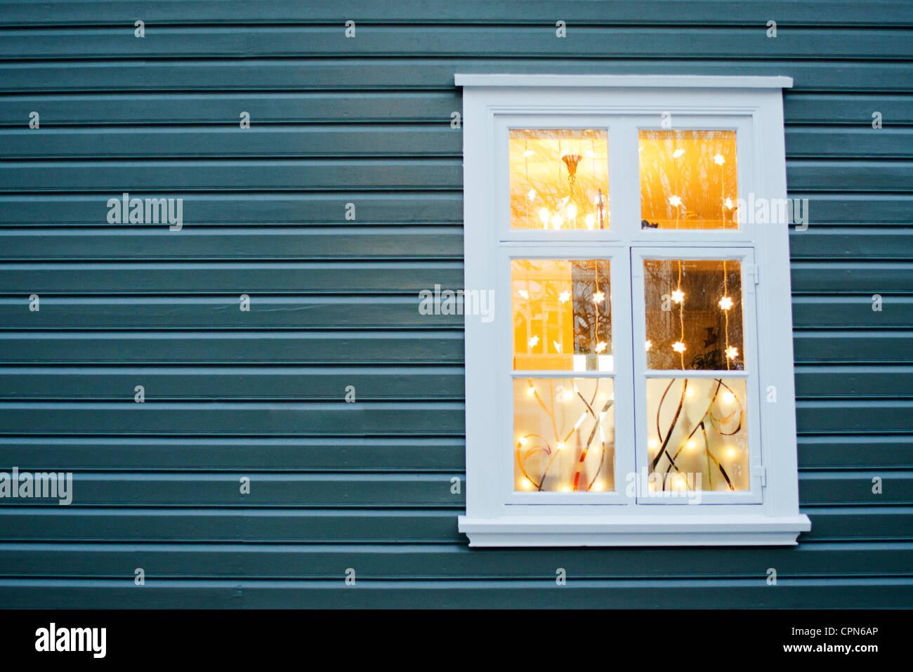 Christmas lights hanging in widow Stock Photo