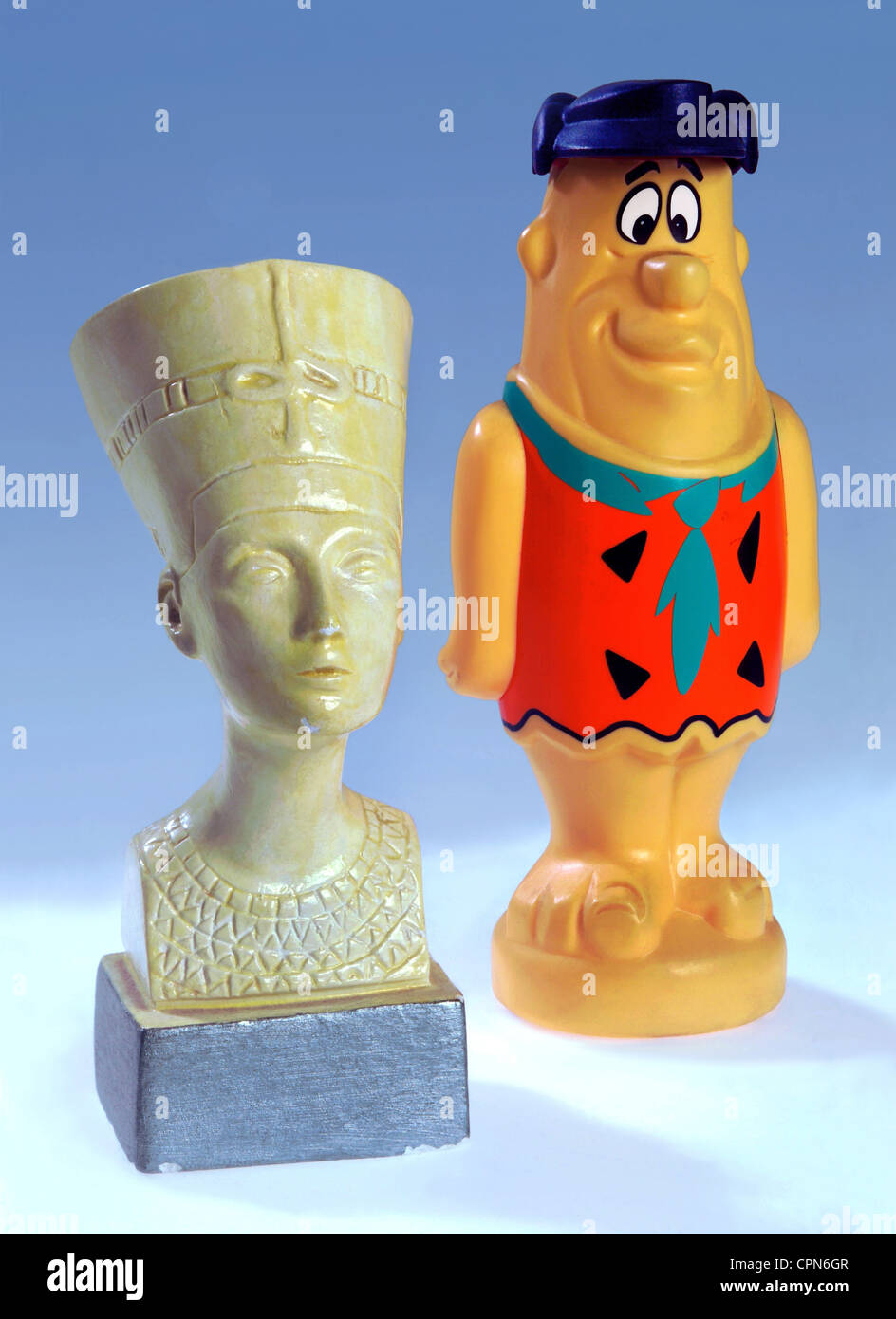 tourism, souvenirs, Nefertiti, Fred Flintstone, plaster bust, plastic figure, Germany, figure, figures, statuette, - Stock Image