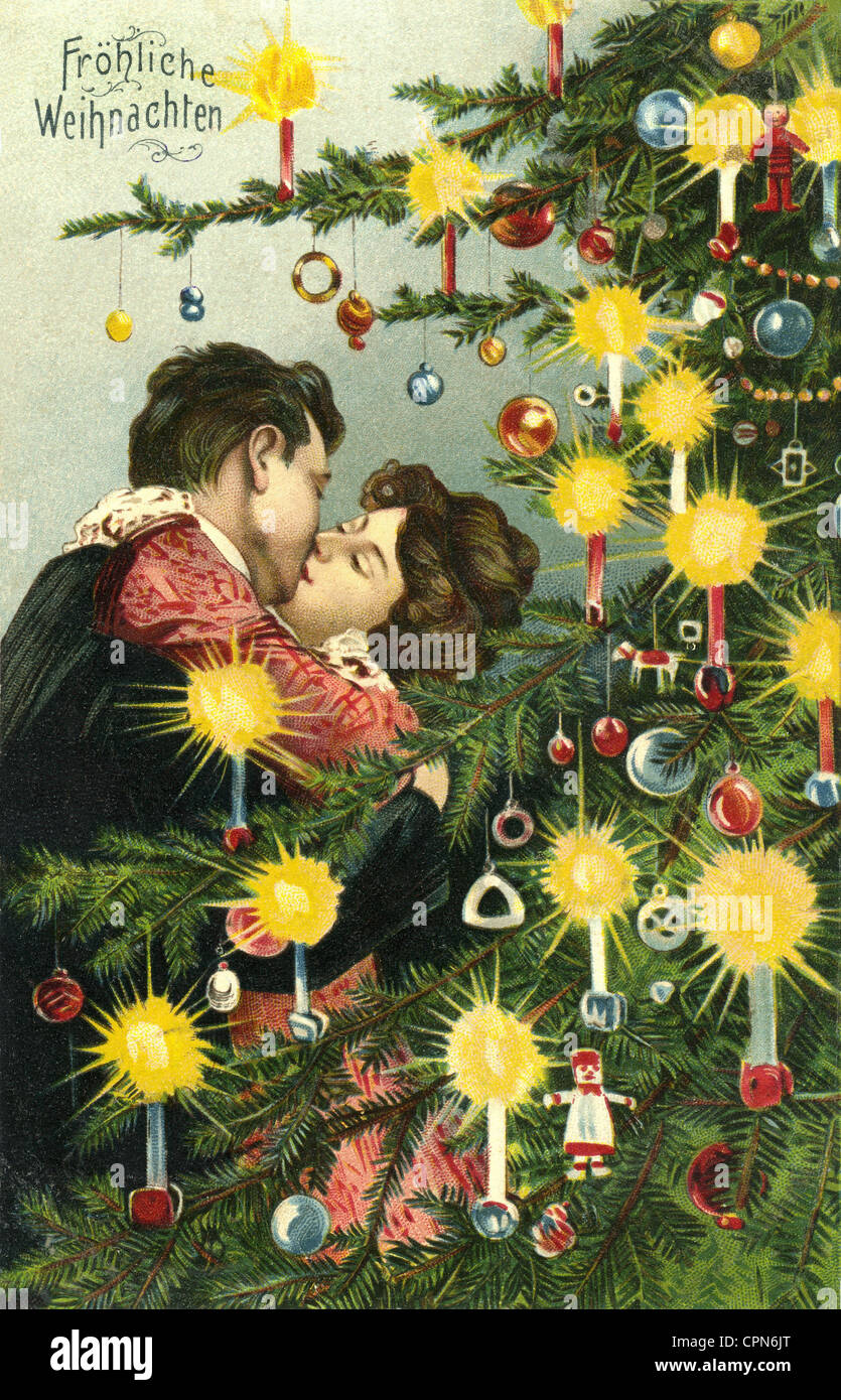 Christmas, cards, couple is kissing under the Christmas tree Stock ...