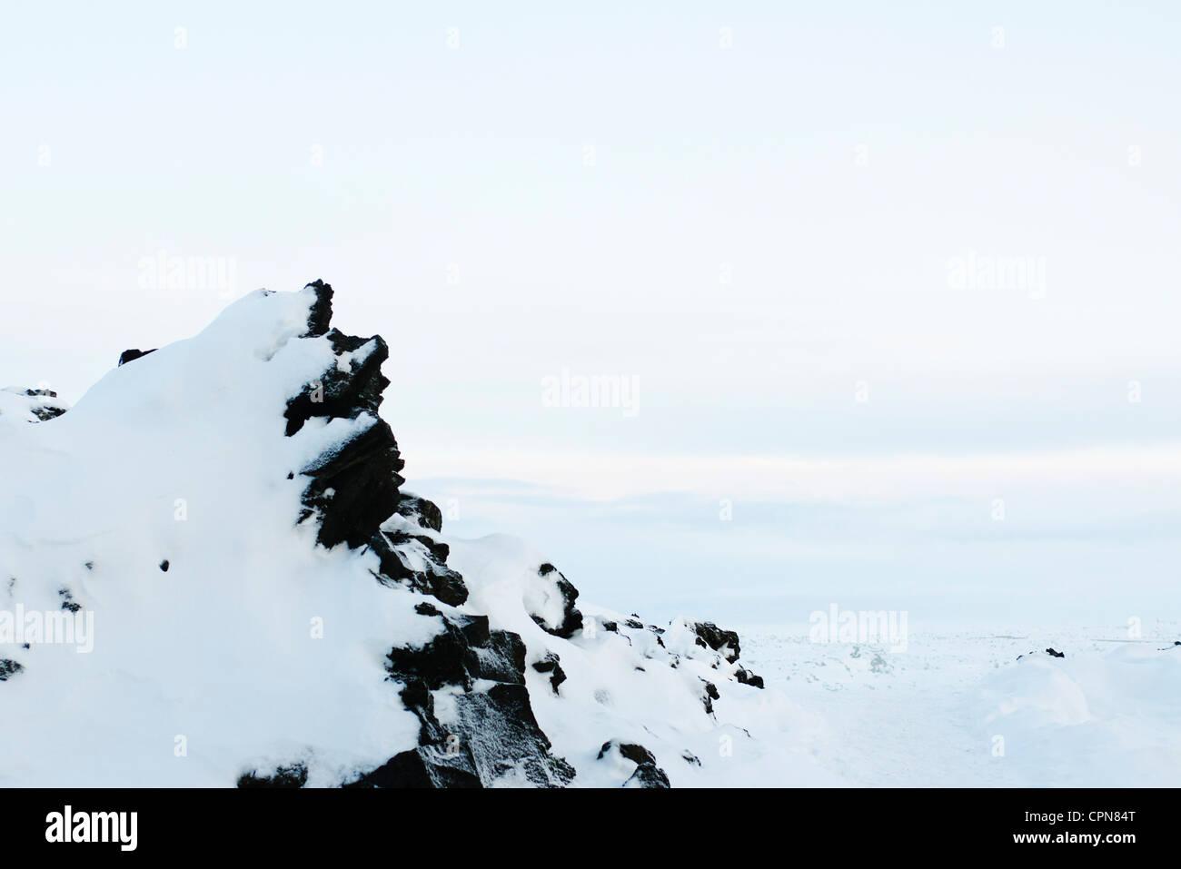 Volcanic rock covered in snow, Reykjanes Peninsula, Iceland - Stock Image