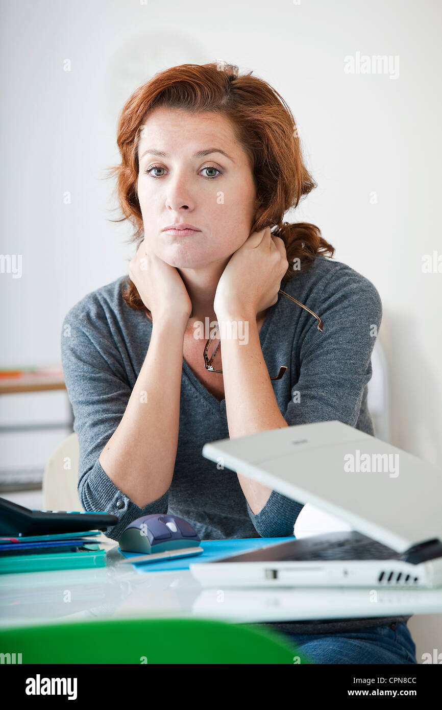 WOMAN WORKING - Stock Image