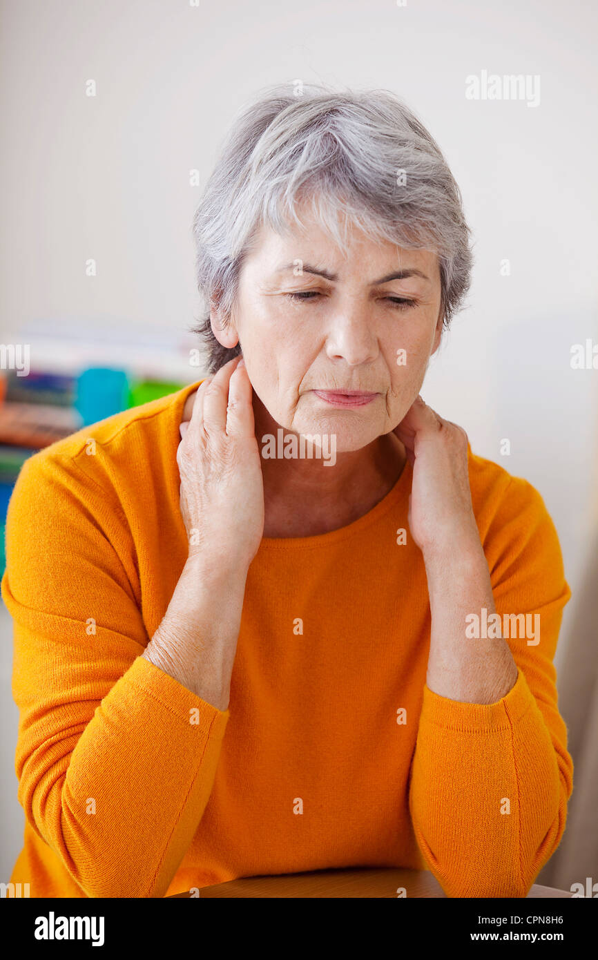 CERVICALGIA IN AN ELDERLY PERSON - Stock Image