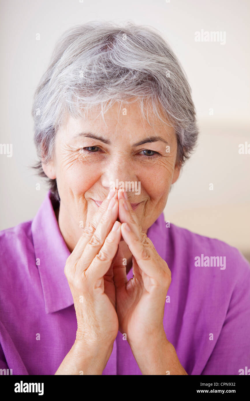ELDERLY PERSON INDOORS - Stock Image