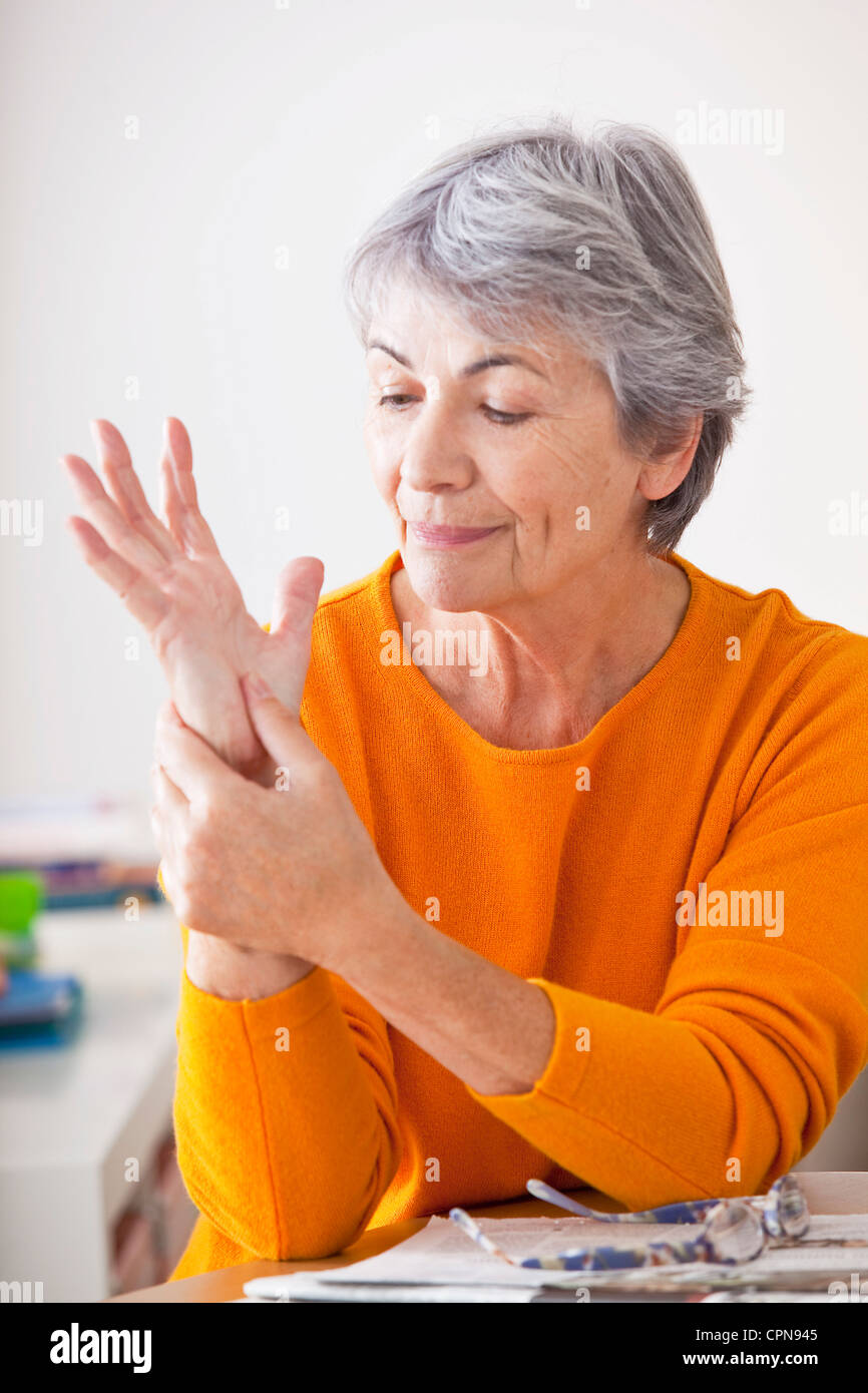 ELDERLY PERS. WITH PAINFUL HAND - Stock Image