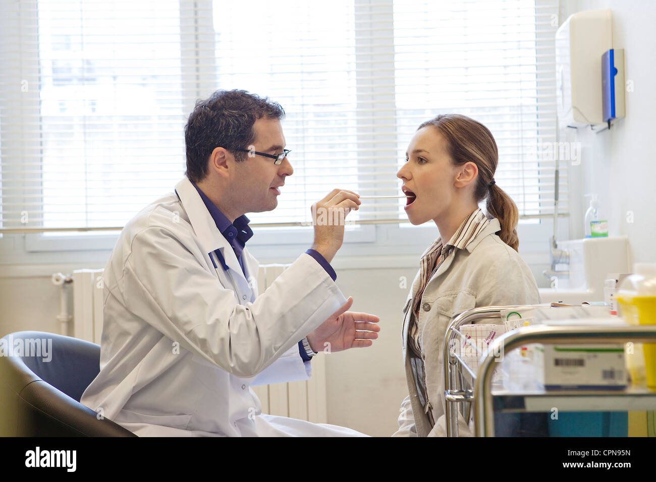 EAR NOSE & THROAT, WOMAN - Stock Image