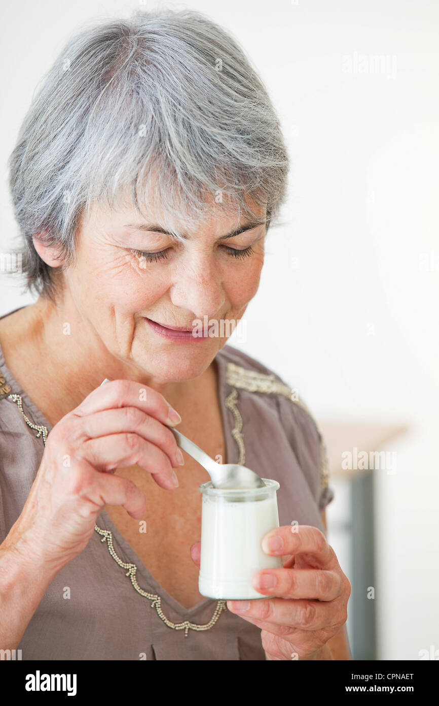 ELDERLY PERSON, DAIRY PRODUCT Stock Photo