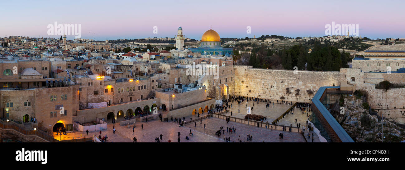 Israel, Jerusalem, Old City, Jewish Quarter of the Western Wall Plaza, with people praying at the wailing wall - Stock Image