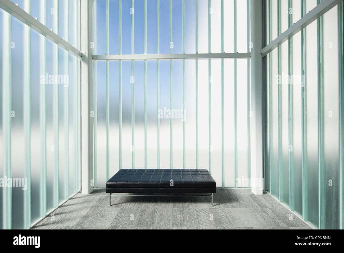 Empty bench in modern lobby - Stock Image
