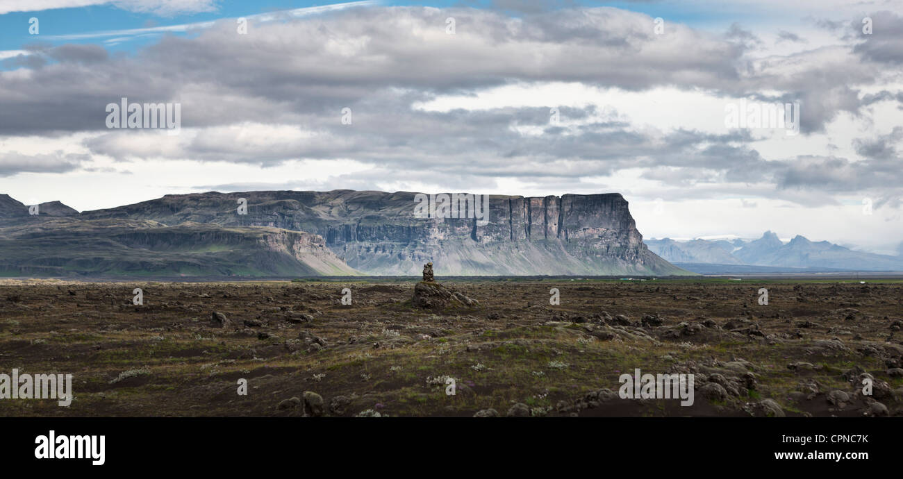 Iceland, panoramic view of lava field and cliffs - Stock Image