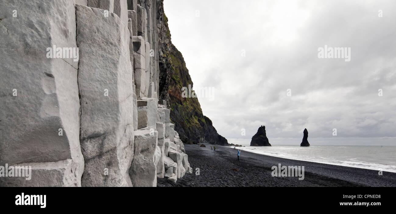 Iceland, Vik, basalt columns and black sand beach - Stock Image