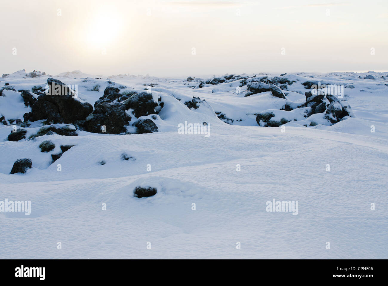 Volcanic rock covered in snow, Reykjanes Peninsula, Iceland - Stock Image