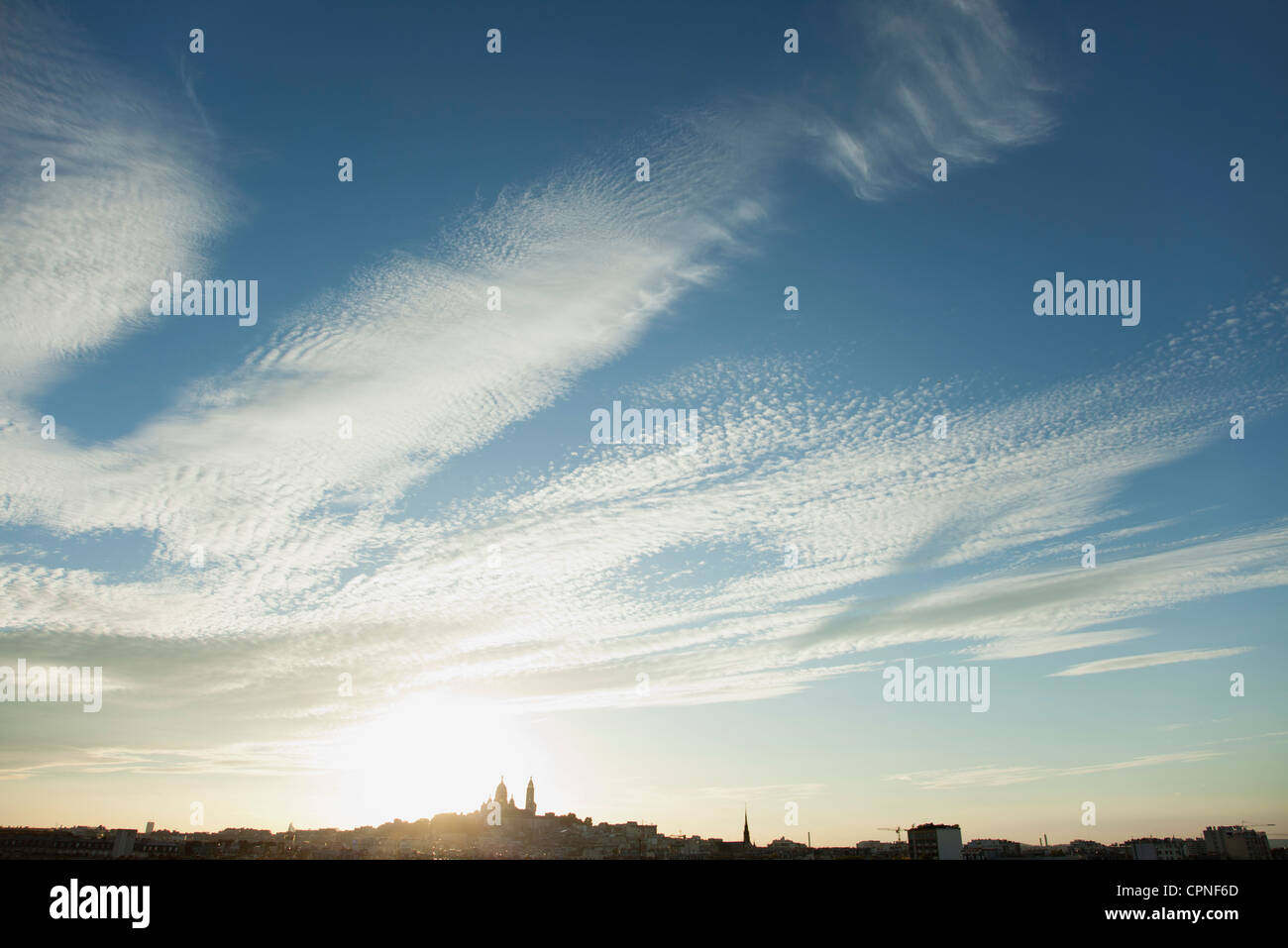 Sun setting over distant skyline of Paris, France Stock Photo