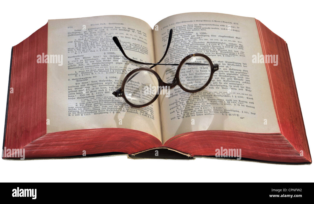 literature, wording of the law from 1896, glasses lying on opened book, Germany, circa 1910, round horn-rimmed glasses, - Stock Image