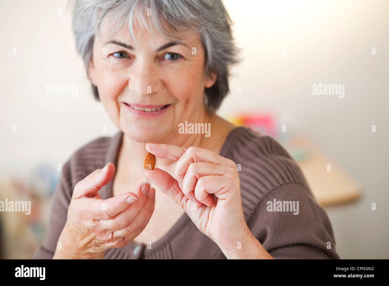 ELDERLY PERSON EATING - Stock Image